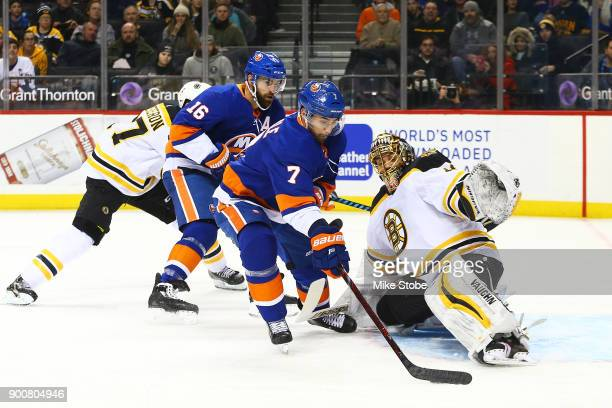 Jordan Eberle of the New York Islanders dekes around Tuukka Rask of the Boston Bruins to score a first period goal at Barclays Center on January 2...