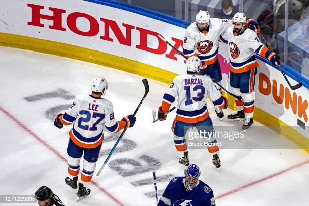 Jordan Eberle of the New York Islanders is congratulated by his teammates after scoring a goal against the Tampa Bay Lightning in Game One of the...