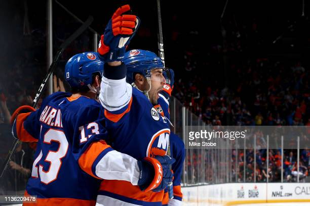 Jordan Eberle of the New York Islanders is congratulated by his teammate Mathew Barzal after scoring a first period goal against the Pittsburgh...