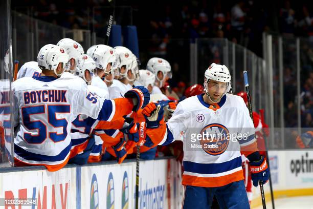Jordan Eberle of the New York Islanders is congratulated by his teammates after scoring his third goal of the game against the Detroit Red Wings...
