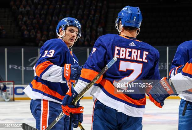 Jordan Eberle of the New York Islanders is congratulated by Mathew Barzal after scoring a goal against the New Jersey Devils during the third period...