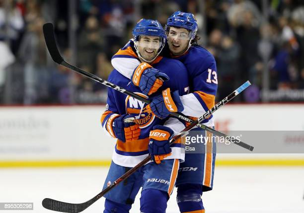 Jordan Eberle of the New York Islanders is congratulated by teammae Mathew Barzal after Eberle scored the game winning goal in overtime against the...