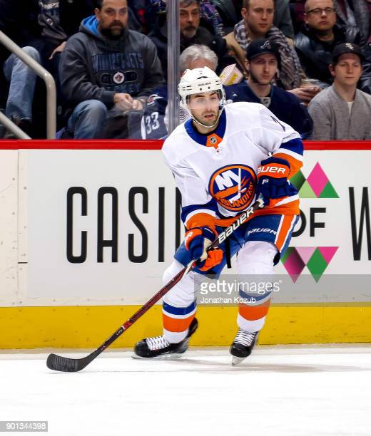 Jordan Eberle of the New York Islanders keeps an eye on the play during first period action against the Winnipeg Jets at the Bell MTS Place on...