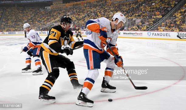 Jordan Eberle of the New York Islanders moves the puck in front of Evgeni Malkin of the Pittsburgh Penguins in Game Three of the Eastern Conference...