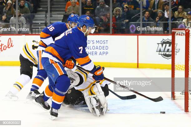 Jordan Eberle of the New York Islanders scores a first period goal against Tuukka Rask of the Boston Bruins at Barclays Center on January 2 2018 in...