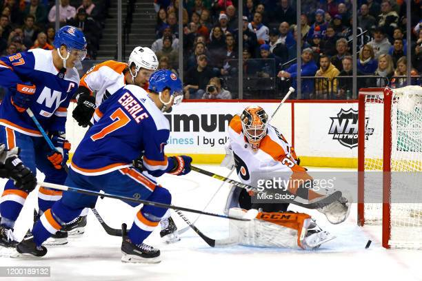 Jordan Eberle of the New York Islanders scores a goal past Brian Elliott of the Philadelphia Flyers during the first period at Barclays Center on...