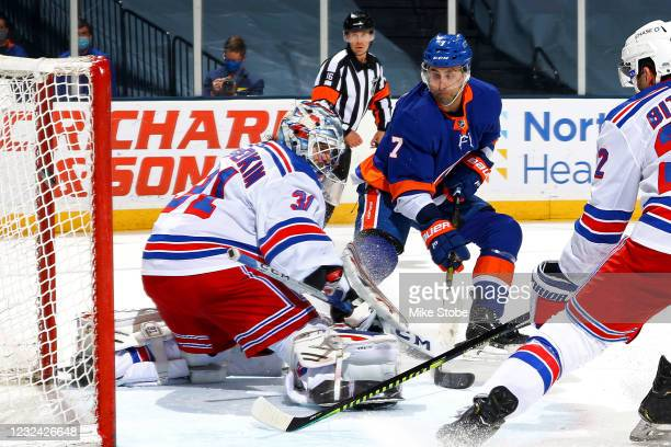 Jordan Eberle of the New York Islanders scores a goal past Igor Shesterkin of the New York Rangers during the third period at Nassau Coliseum on...