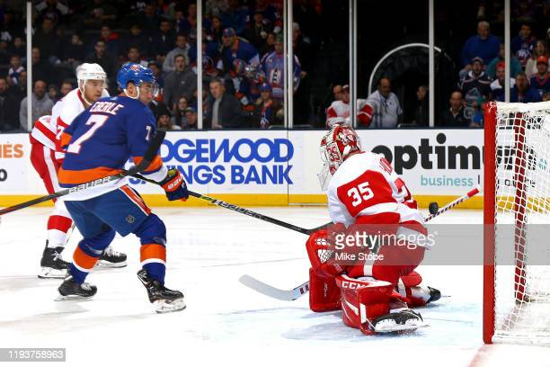 Jordan Eberle of the New York Islanders scores a goal past Jimmy Howard of the Detroit Red Wings during the first period at NYCB Live's Nassau...