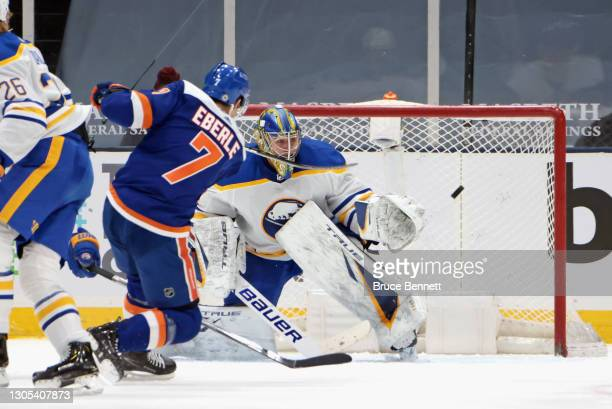 Jordan Eberle of the New York Islanders scores a third period goal against Jonas Johansson of the Buffalo Sabres at the Nassau Coliseum on March 04,...
