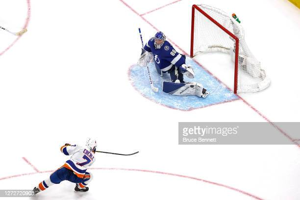 Jordan Eberle of the New York Islanders scores the gamewinning goal past Andrei Vasilevskiy of the Tampa Bay Lightning during the second overtime...
