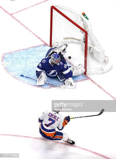 Jordan Eberle of the New York Islanders scores the game-winning goal past Andrei Vasilevskiy of the Tampa Bay Lightning during the second overtime...
