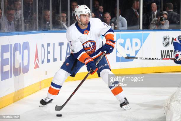 Jordan Eberle of the New York Islanders skates with the puck against the New York Rangers at Madison Square Garden on October 19 2017 in New York...