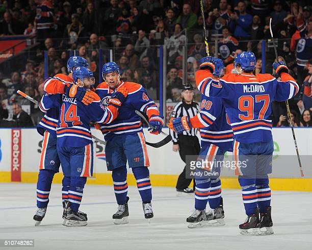 Jordan Eberle Taylor Hall Brandon Davidson and Connor McDavid of the Edmonton Oilers celebrate after a goal during a game against the Anaheim Ducks...