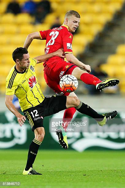 Jordan Elsey of Adelaide United and Blake Powell of the Phoenix compete for the ball during the round 22 ALeague match between the Wellington Phoenix...