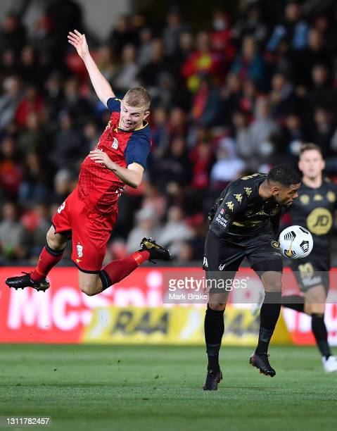 Jordan Elsey of Adelaide United fouled by Kwame Yeboah of the Wanderers during the A-League match between Adelaide United and the Western Sydney...