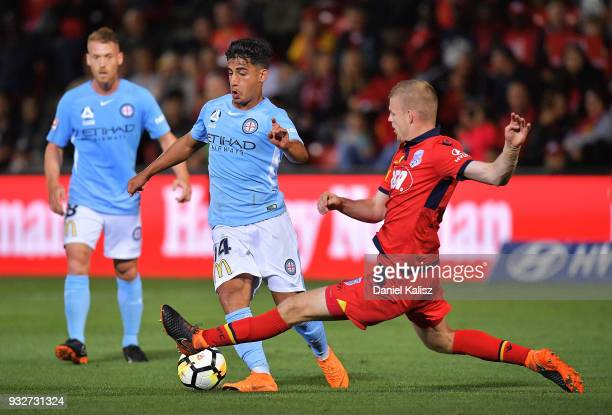 Jordan Elsey of United receives a yellow card for a tackle on Daniel Arzani of Melbourne City during the round 23 ALeague match between Adelaide...