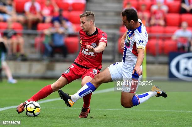 Jordan Elsy of Adelaide is cut down by Nikolai ToporStanley given a yellow card during the round six ALeague match between Adelaide United and the...