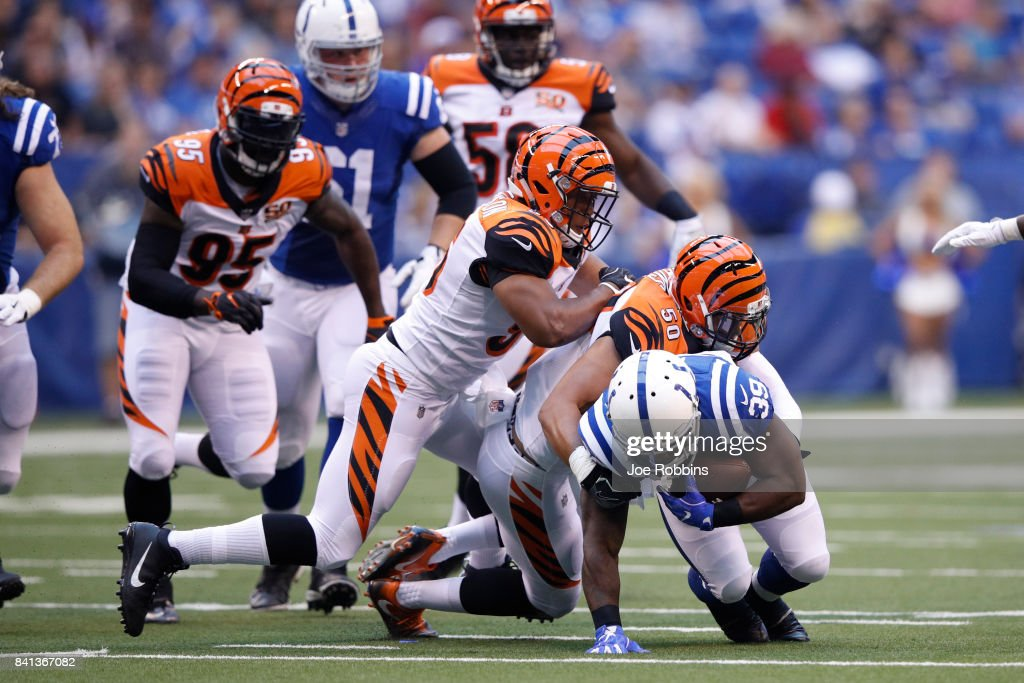 Jordan Evans #50 and Hardy Nickerson #56 of the Cincinnati Bengals tackle Troymaine Pope #39 of the Indianapolis Colts in the first half of a preseason game at Lucas Oil Stadium on August 31, 2017 in Indianapolis, Indiana.