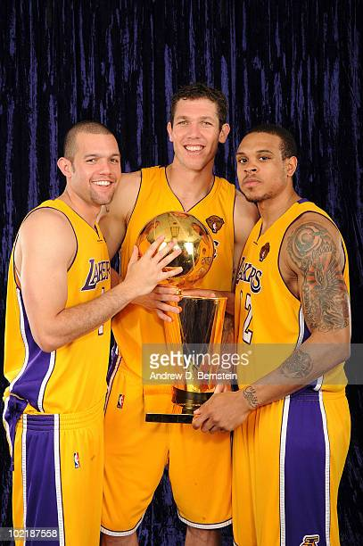 Jordan Farmar Luke Walton and Shannon Brown of the Los Angeles Lakers hold the Larry O'Brien Trophy following their team's victory over the Boston...