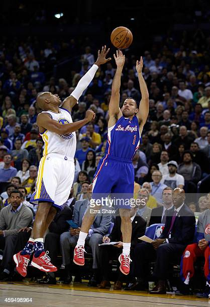 Jordan Farmar of the Los Angeles Clippers shoots over Leandro Barbosa of the Golden State Warriors at ORACLE Arena on November 5 2014 in Oakland...