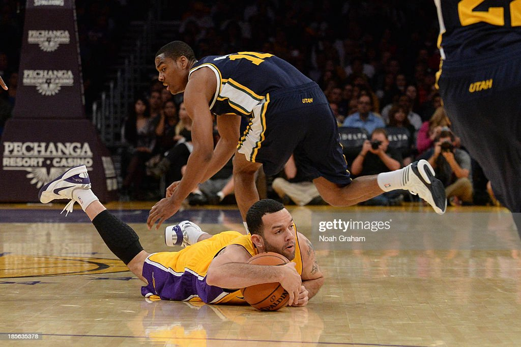 Jordan Farmar #1 of the Los Angeles Lakers chases after a loose ball against the Utah Jazz at Staples Center on October 22, 2013 in Los Angeles, California.
