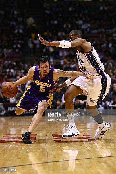 31ac0095333 Jordan Farmar of the Los Angeles Lakers drives against the New Jersey Nets  during the game