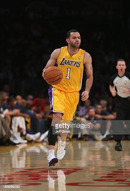 Jordan Farmar of the Los Angeles Lakers drives down the court against the Utah Jazz at Staples Center on October 22 2013 in Los Angeles California...
