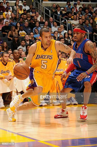 Jordan Farmar of the Los Angeles Lakers drives past Allen Iverson of the Detroit Pistons during the game on November 14 2008 at Staples Center in Los...