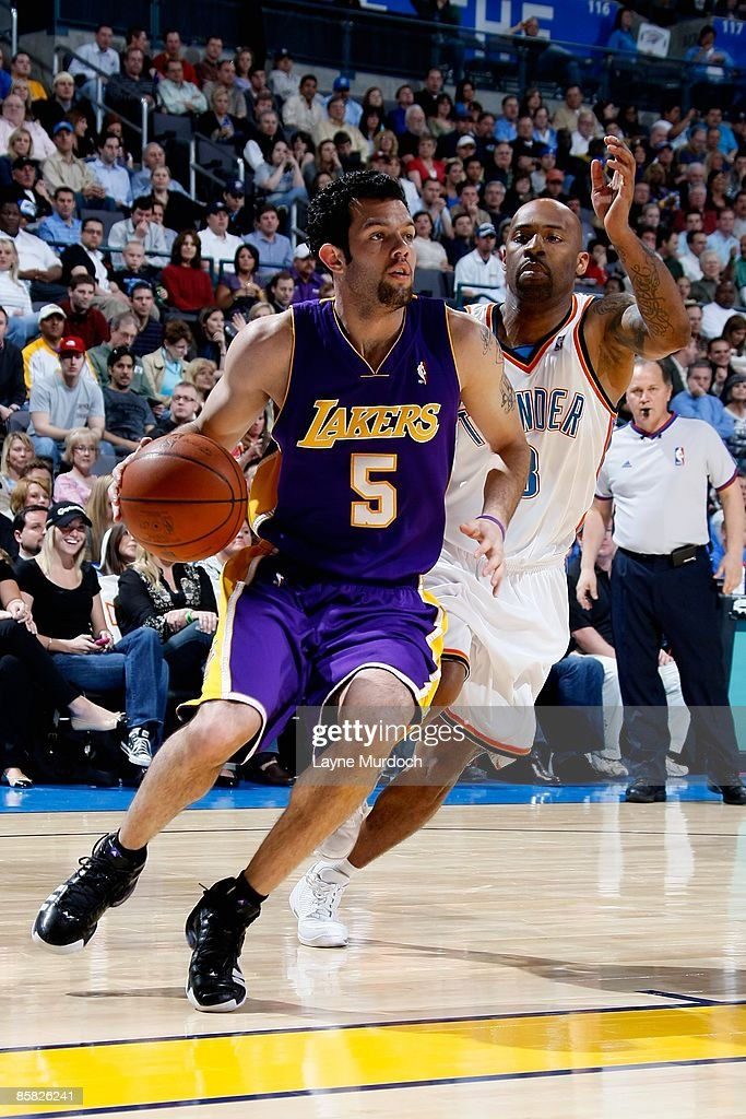 c1f3a1b172097b Jordan Farmar of the Los Angeles Lakers drives past Chucky Atkins of ...