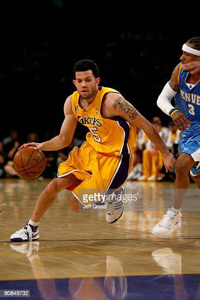 Jordan Farmar of the Los Angeles Lakers drives to the basket past Allen Iverson of the Denver Nuggets in Game Two of the Western Conference...