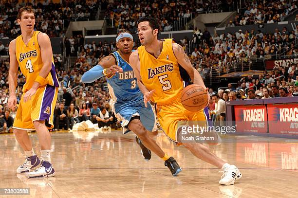 Jordan Farmar of the Los Angeles Lakers drives to the hoop against Allen Iverson of the Denver Nuggets on April 3 2007 at Staples Center in Los...
