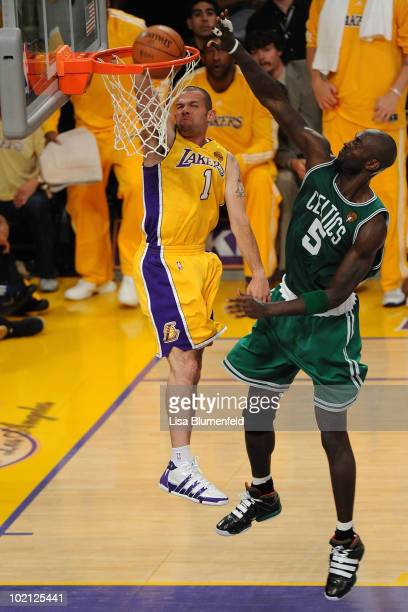 Jordan Farmar of the Los Angeles Lakers dunks the ball in front of Kevin Garnett of the Boston Celtics in Game Six of the 2010 NBA Finals at Staples...