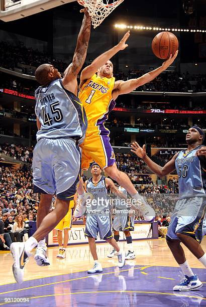 Jordan Farmar of the Los Angeles Lakers goes to the basket under pressure against Steven Hunter of the Memphis Grizzlies during the game on November...