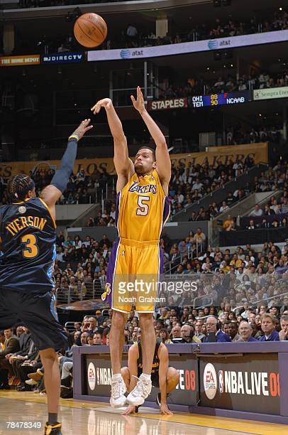 Jordan Farmar of the Los Angeles Lakers shoots a jump shot over Allen Iverson of the Denver Nuggets during the game at Staples Center on November 29...