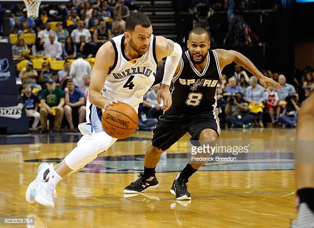 Jordan Farmar of the Memphis Grizzlies dribbles past Patty Mills of the San Antonio Spurs during the first half of game three of the Western...