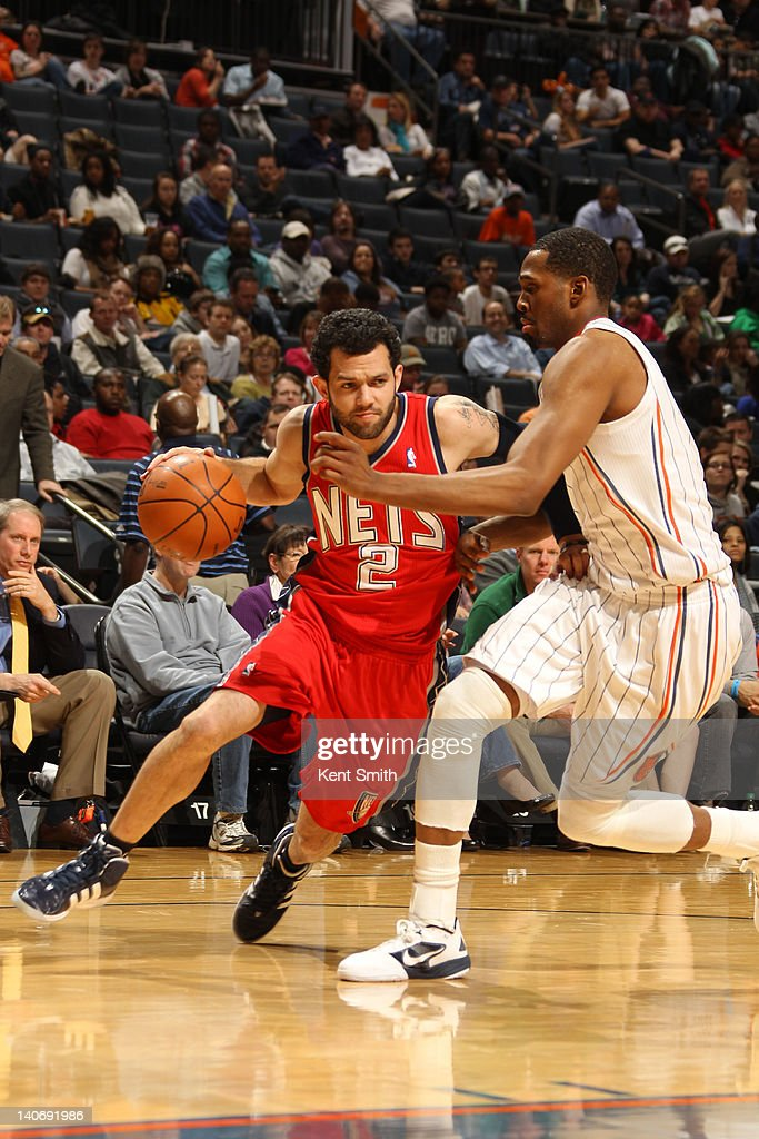 Jordan Farmar #2 of the New Jersey Nets drives to the basket against Derrick Brown #4 of the Charlotte Bobcats during the game at the Time Warner Cable Arena on March 4, 2012 in Charlotte, North Carolina.