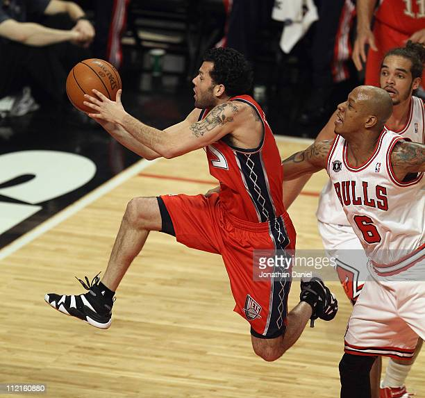 Jordan Farmar of the New Jersey Nets drives to the basket past Keith Bogans of the Chicago Bulls at United Center on April 13 2011 in Chicago...