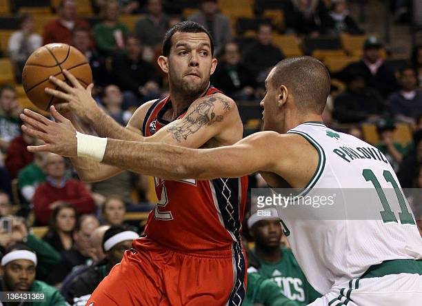 Jordan Farmar of the New Jersey Nets passes the ball as Sasha Pavlovic of the Boston Celtics defends on January 4 2012 at TD Garden in Boston...