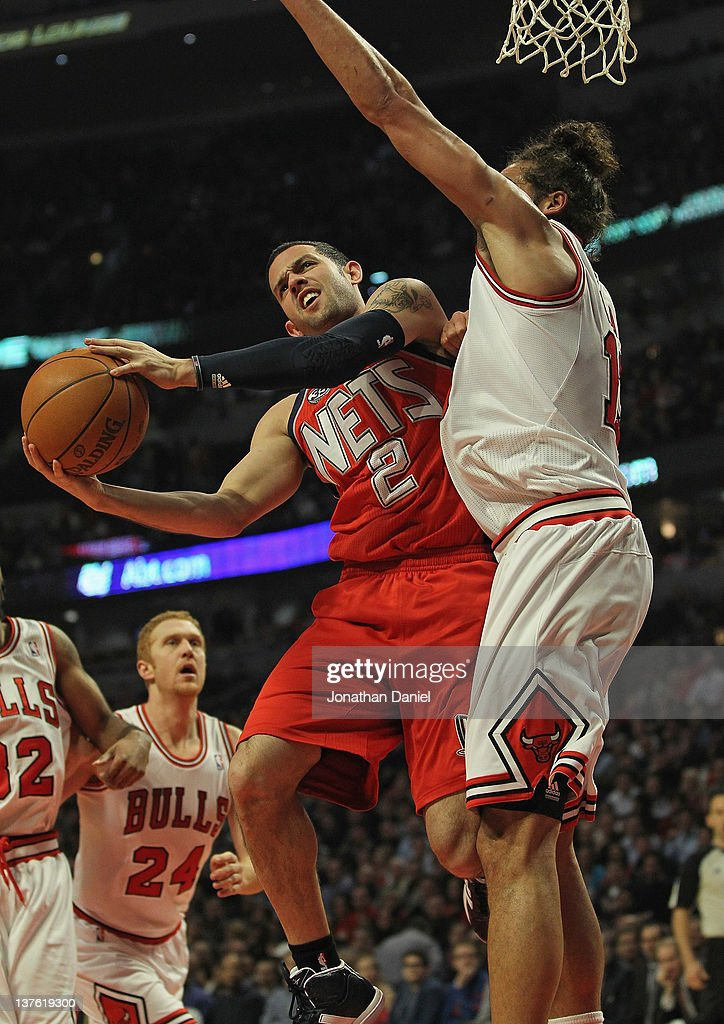 Jordan Farmar #2 of the New Jersey Nets puts up a shot against Joakim Noah #13 of the Chicago Bulls at the United Center on January 23, 2012 in Chicago, Illinois.