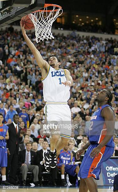 Jordan Farmar of the UCLA Bruins puts a layup in around the defense of Chris Richard of the Florida Gators in the first half during the National...