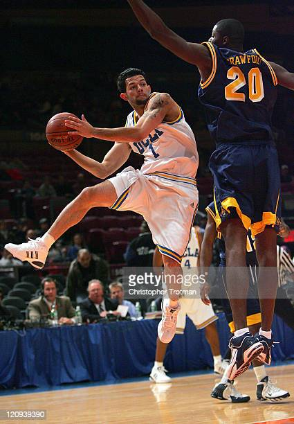 Jordan Farmar of the UCLA Bruins shoots around Crawford of the Drexel University Dragons in the consolation game of the NIT Tip Off at Madison Square...
