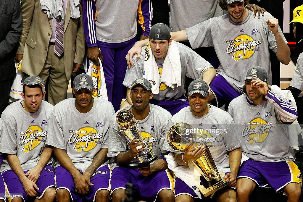 Jordan Farmar #5, Trevor Ariza #3, Kobe Bryant #24, Luke Walton #4, Derek Fisher #2, Pau Gasol #16 and Sasha Vujacic #18 of the Los Angeles Lakers pose together after defeating the Orlando Magic in Game Five of the 2009 NBA Finals on June 14, 2009 at Amway Arena in Orlando, Florida. The Lakers won 99-86.