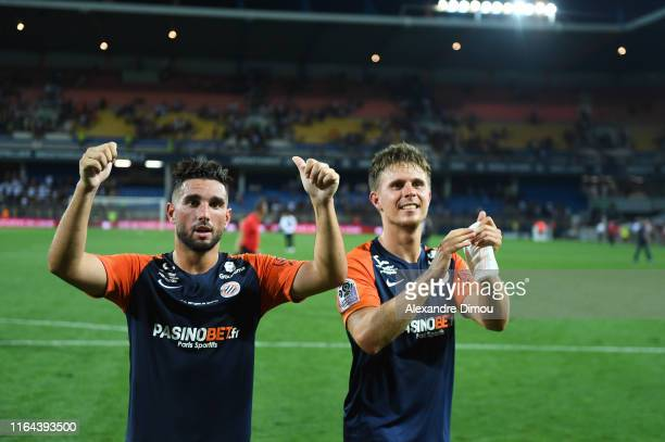 Jordan Ferri of Montpellier and Arnaud Souquet of Montpellier celebrates the victory and during the Ligue 1 match between Montpellier and Lyon at...