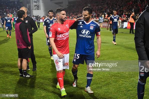Jordan Ferri of Nimes and Jeremy Morel of Lyon during the Ligue 1 ...