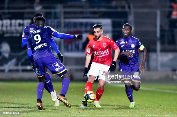 Jordan Ferri of Nimes and Yaya Sanogo and MAx Alain Gradel of Toulouse during the Ligue 1 match between Nimes and Toulouse at Stade des Costieres on...