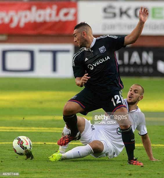 Jordan Ferri of Olympique Lyon fights for a ball with Jiri Skalak of FK Mlada Boleslav during the Europa League 3rd qualifying round first leg...