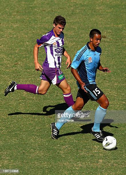 Jordan Figon of Sydney pushes forward past Alec Jovic of Perth during the round 15 Youth League match between Sydney FC and Perth Glory at Sydney...