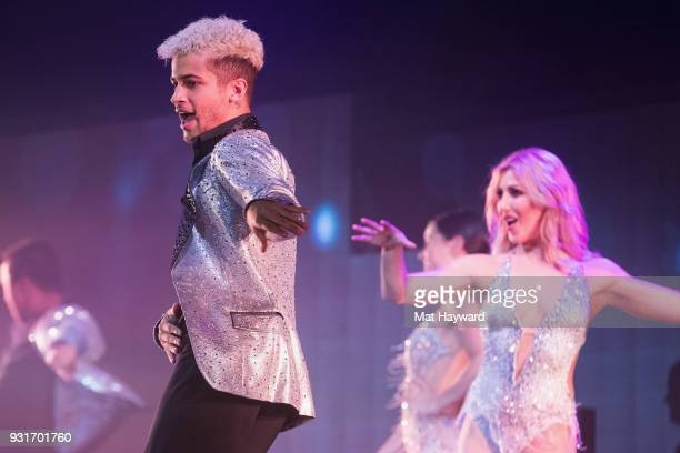 Jordan Fisher and Emma Slater perform on stage during Dancing With The Stars Live at WaMu Theater on March 13 2018 in Seattle Washington