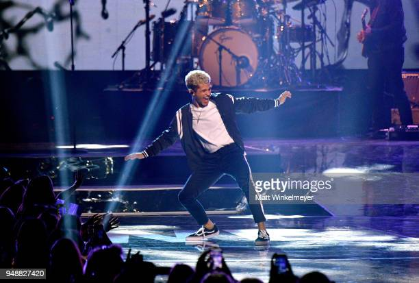 Jordan Fisher performs onstage at WE Day California at The Forum on April 19 2018 in Inglewood California
