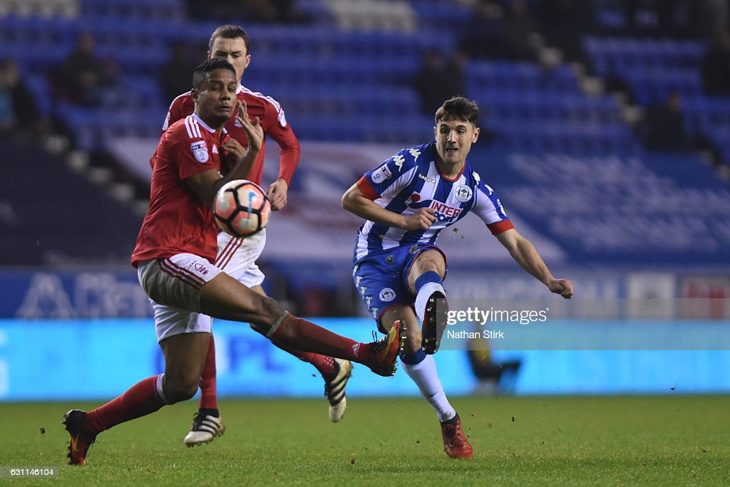 Jordan Flores of Wigan Athletic and Michael Mancienne of Nottingham Forest in action during the Emirates FA Cup Third Round match between Wigan Athletic and Nottingham Forest at the DW Stadium on January 7, 2017 in Wigan, England (Photo by Nathan Stirk/Getty Images).
